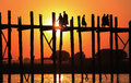 Monks crossing u bein bridge sunset amarapura myanmar burma Stock Images