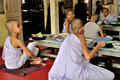 Monks eating lunch prepare to eat in maha ganayon kyaung monastery mandalay myanmar Stock Image