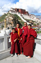 Monks in front of Potala Palace Stock Photo