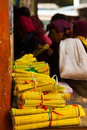 Monks gather to purchase mass produced yellow tibetan prayer scrolls at a store in zhongdian china Stock Photography