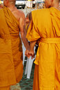 Monks holding hands Royalty Free Stock Photography