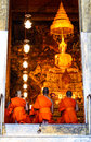Monks pray in the evening in Wat Pho Temple. Royalty Free Stock Image