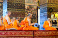 Monks pray in the evening in Wat Pho Temple Stock Image