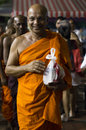 Monks a smiling to devotees during wesak eve Royalty Free Stock Photos