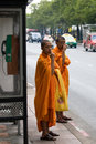 Monks Waiting for Transport Royalty Free Stock Photography