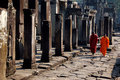 Monks walking in cambodia angkor wat temple harmony Royalty Free Stock Images