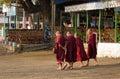 Monks walking on street in Mandalay, Myanmar