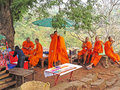 Monks at wat phu laos having a break after walking up to temple a famous unesco world heritage site is a ruined khmer temple Royalty Free Stock Photography
