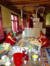 Monks at work preparing sweets and decorating a prayer hall for the annual festival thiksay monastery in leh ladakh region india Royalty Free Stock Photo