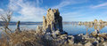 Mono lake tufa panorama view of rock in nevada with reflection from more rocks Royalty Free Stock Photo