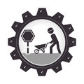 Monochrome gear wheel with man and wheelbarrow