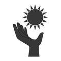 Monochrome hand holding a sun shape