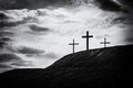 Monochrome image of three crosses sitting on a hill Royalty Free Stock Photo