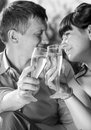 Monochrome portrait of just married couple drinking champagne closeup Royalty Free Stock Images