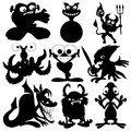 Monster black silhouettes on white background Stock Photos