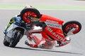 Monster energy grand prix of catalunya motogp drivers jordi torres and dominique aegerter moto crash moto barcelona spain june Stock Image