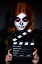 Monster with movie clapper board Royalty Free Stock Images