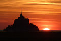 Mont saint michel france is a tiny island in normandy seen in silhouette at sunset Royalty Free Stock Image