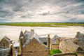 Mont saint michel monastery and bay normandy france landmark in low tide bad weather europe Stock Images