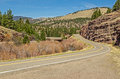 Montana frontage road winding with beautiful scenery and a mph curve coming up on a in spring Royalty Free Stock Photos