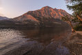 Montana morning early light on mountain reflecting in lake saint mary in glacier national park Stock Photography