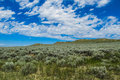 Montana plains clouds floating over a beautiful plain Royalty Free Stock Image