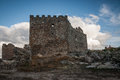 Montanchez castle ruins in Spain, lateral view with toppled walls and battlements Royalty Free Stock Photo