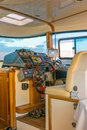 The captain of the yacht activated the autopilot and left its control seat. Royalty Free Stock Photo