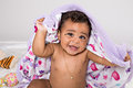 Month old baby smiling with blanket girl and playing purple Stock Photo