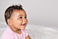 Month old baby smiling girl profile Stock Images