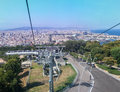 Montjuic barcelona city telepheric and the of with its historical and modern buildings catalunia spain Stock Image
