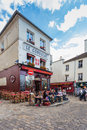 Montmartre area is among most popular destinations in paris france may view of typical cafe on may le consulat a Royalty Free Stock Photography