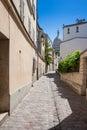 Montmartre rue saint rustique paris france the street of with basilique du sacre coeur at the background Stock Photo