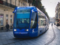 Montpellier france march a man is driving a blue tramway between the train station and the main plaza place de la comédie in the Royalty Free Stock Image