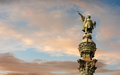 Monument of christopher columbus in barcelona pointing towards america during golden sunset catalonia spain Stock Photo