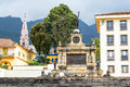 Monument and church to the battle of ayacucho with el carmen visible in the background in the center of bogota colombia Royalty Free Stock Photos