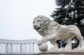 A monument of a lion with a ball Royalty Free Stock Photo