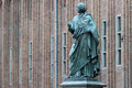 Monument nicolaus copernicus in torun to the astronomer against town hall poland Royalty Free Stock Photography