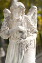 Monument to an angel on a cemetery Royalty Free Stock Photo