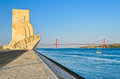 Monument to the discoveries lisbon and de abril bridge in portugal Stock Image