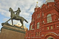 Monument to georgy zhukov on a horse on a background of the historical museum moscow russia sitting over his head blue sky with Stock Photos