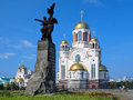 Monument to Komsomol of Ural and churches in Yekaterinburg Royalty Free Stock Photo