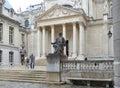 Monument to Louis Pasteur against the Chapelle de la Sorbonne in Paris Royalty Free Stock Photo