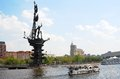 Monument to peter the great and moscow city panorama a cruise ship sails on river blue sky with clouds background a Royalty Free Stock Photography