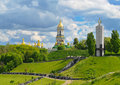 Monument to victims of holodomor and kiev pechersk lavra in kiev domes on green hills park fame kyiv ukraine Stock Photography