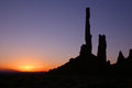 Monument valley sunrise silhouette of rock formation at arizona Stock Images