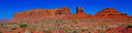 Monument valley x s eagle mesa panorama a view of three famous formations known as the sitting hen and douglas butte this is Stock Images