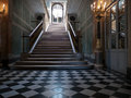 Monumental stairs in a palace wide of marble and black and white checker board tiles Royalty Free Stock Photography