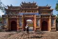 Monuments of hue vietnam an unidentified tourist takes a picture the gateway dien tho in the protected by unesco old imperial city Stock Image
