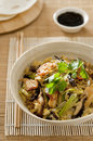 Moo shu chicken a classic chinese dish with fried napa cabbage shiitake mushrooms green onions and egg served with steamed Stock Image
